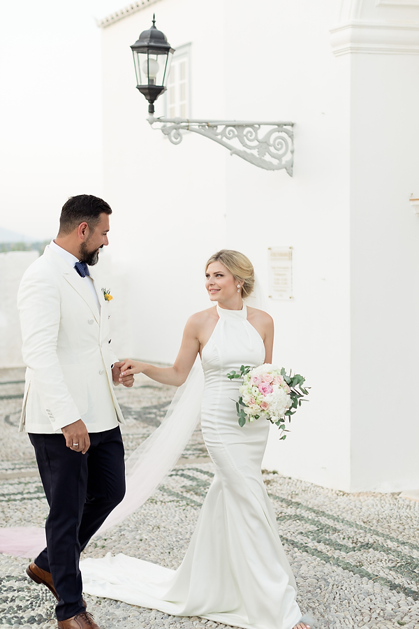 Portrait of elegant and classy couple after their wedding in Greece. Wedding venue kaiki in Spetses.