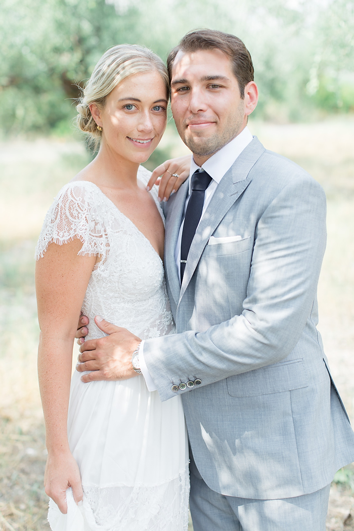 Couple's portrait by the olives. Wedding planner in Greece exclusive wedding tales. Wedding photographer reviews and kind words.