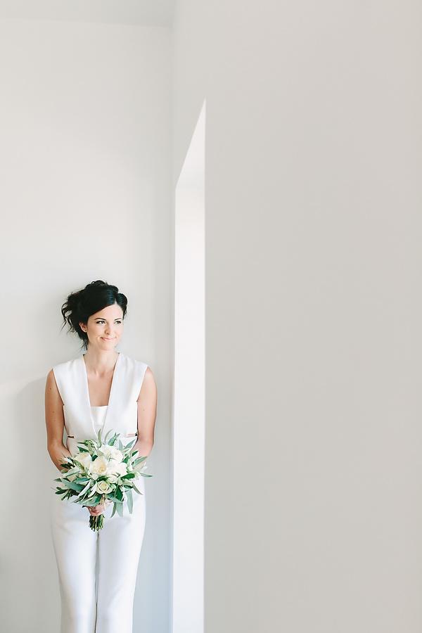 Posing as a bride for her wedding in Santorini Greece at venetsanos winery. Bridal photographer Vasilis Kouroupis