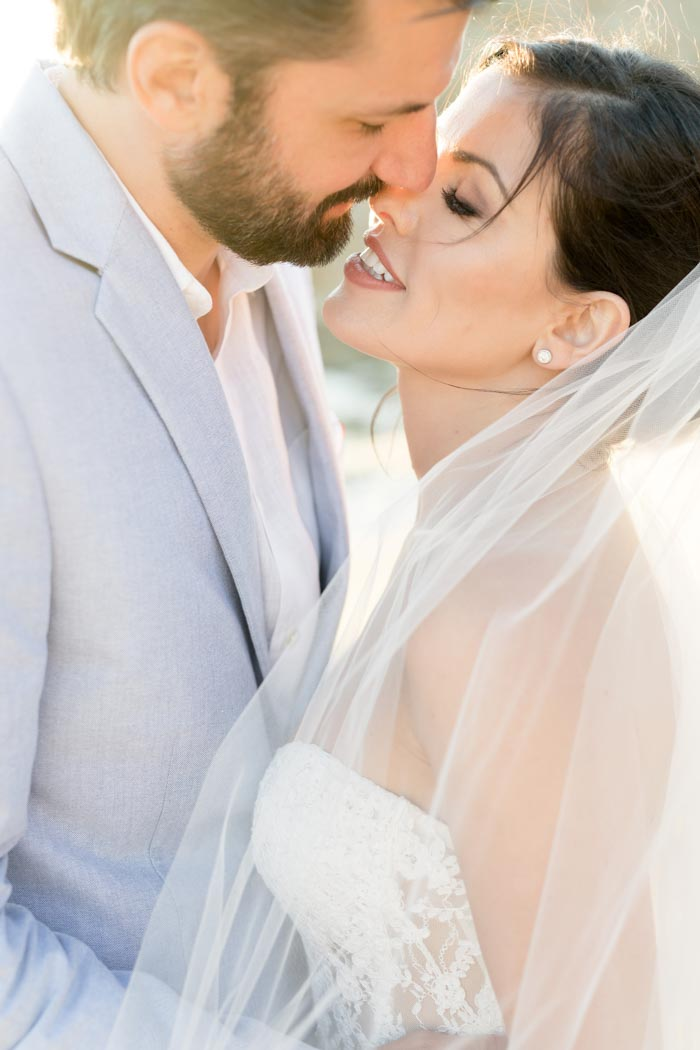 First time kissing as newlyweds after their wedding in Mykonos Greece
