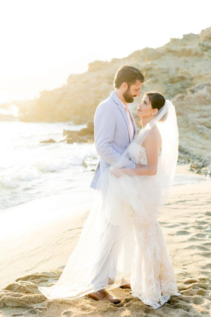 Portrait of a couple after their wedding in Alemagou beach wedding venue in Greece
