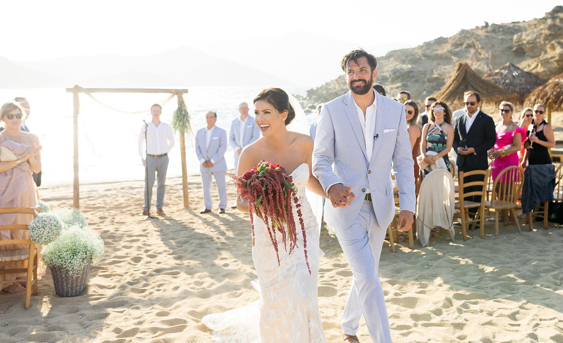 Portrait of the couple after their beach wedding in Mykonos island in Greece Alemagou bar