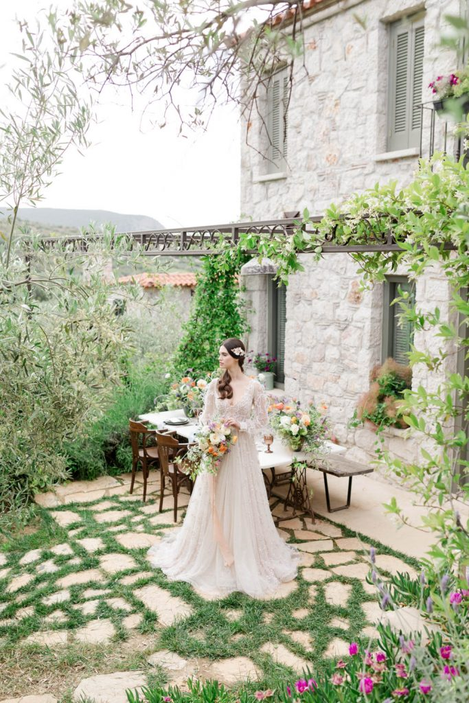 Bride wearing her wedding dress designed by made bride Antonea in an organic wedding in Opora Nafplio Greece