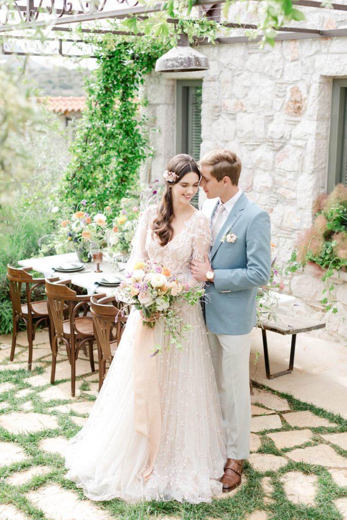 Couple portrait after wedding in Greece - Groom is hugging his bride in Opora Nafplio