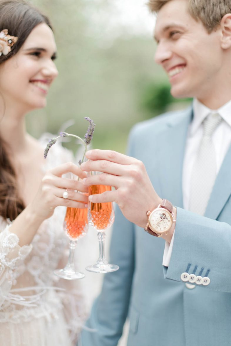 Cheers. Wedding celebration after the ceremony with a glass of champagne. Cheers to the couple