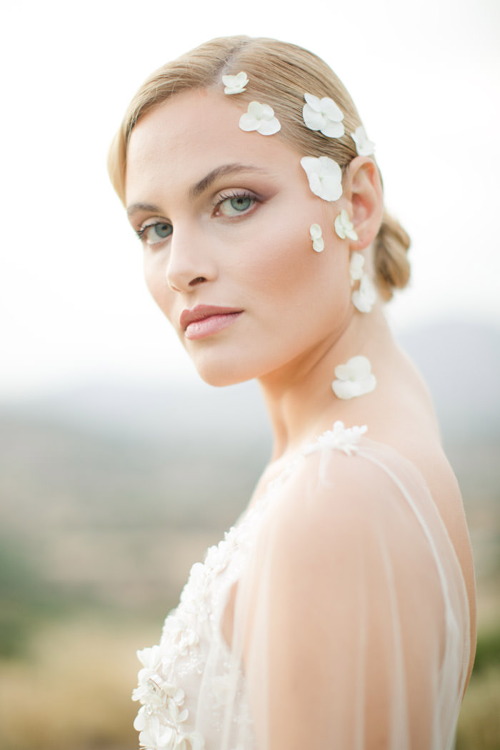 Editorial beauty photography session in Greece with flowers on head like fairytale. Bridal make up and hair by Georgia Christodoulou beauty expert