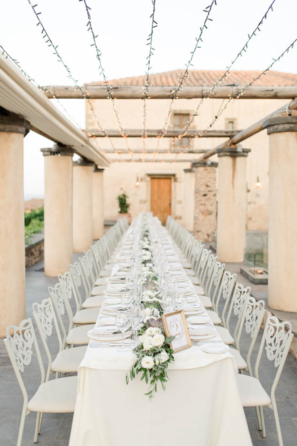 kinsterna wedding hotel one of the most beautiful wedding locations in greece. Table setup for 80guests