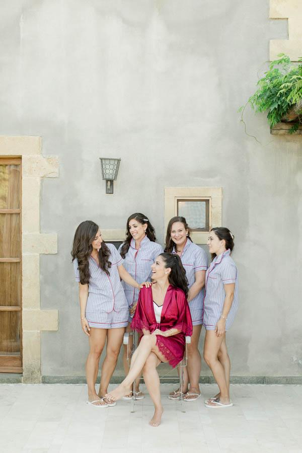 Bride and her bridesmaids posing in kinsterna hotel before the wedding in Greece, Photographer in Monemvasia Vasilis Kouroupis
