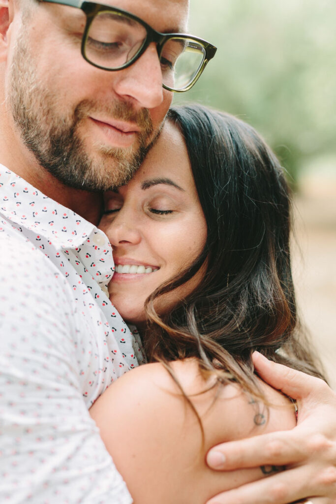 wedding photographer in greece - close up of couple hugging each other very tight with love